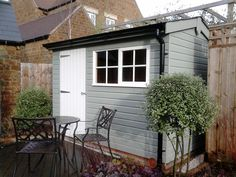 Installed in North London our Superior Shed  Our customers opted to have a workbench included underneath the opening Georgian window to provide storage space and a practical work area.   1.8 x 3.0m Superior Shed Single Door Opening Window Georgian windows Work Bench Guttering Grey Slate Effect Roofing Tiles Valtti Paint System – Lizard with Ivory Windows and Door