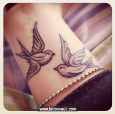 Cute bird tattoo on wrist