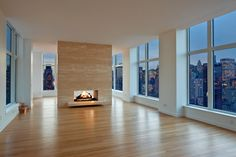 penthouse modern double-sided fireplace with awesome city views - this is the way I'd do city living if I could!
