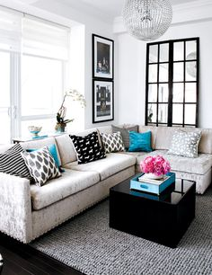 love the fabric/color/studs on that couch!