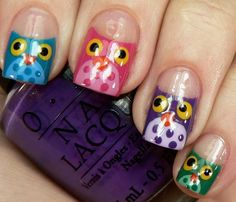 Cute owl face nail design.