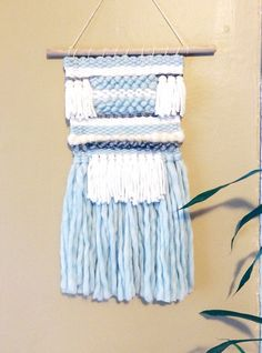 This pale blue, grey and white weaving would be a beautiful addition to any space. It was made with love in my home.