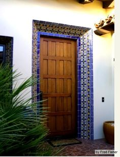 Mediterranean tile design, tile door trim, blue tile