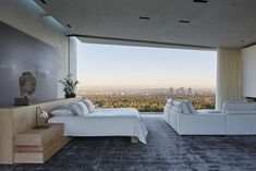 Perched high above the city of Los Angeles on nearly eight acres in the exclusive enclave of Bel Air, the private residence is a cinematic tour de force, cap...