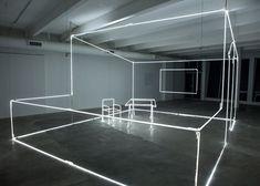 Installation comprising neon tubes sculpted into a room.http://decdesignecasa.blogspot.it