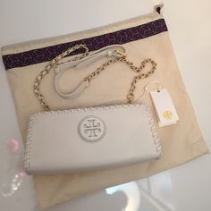 """Tory Burch Marion Crossbody Clutch Bag Lush, pebbled leather shapes an earthy clutch fronted with a tonal logo patch, while an optional chain strap adds effortless versatility.  Sold out; HTF style. Authentic. NWT Top zip closure. Interior wall pocket. Logo-jacquard lining. Leather. 10""""W x 4.5""""H x 2.5""""D  ❌No trades. Tory Burch Bags Crossbody Bags"""