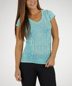 A woman's wardrobe isn't complete without a simple, well-fitting tee, and this one features slimming properties that help flatten the midsection. From the gym to post-workout errands, this top creates a fit, trim and fashionable look.