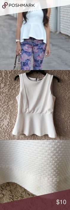 White Peplum Top H&M white peplum top. Great wear to the office. Bodice front is lined. Back close zipper. Two tiny flaws, not that noticeable.   Arm pit to arm pit: 15 inches Length: 23 inches  { Posh Ambassador } { 700+ Sales }  | No trades | H&M Tops