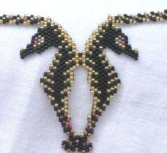 jayceepatterns.com: Midnight Seahorses pendant (buy pattern at http://www.jayceepatterns.com/Pendantspg1.html)