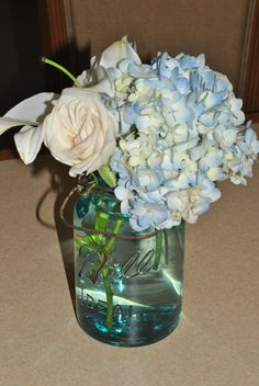 ball jars for flower centerpieces are simple and elegant.  You can also spray paint the clear jars silver and it gives a neat look against a white linen table cloth.