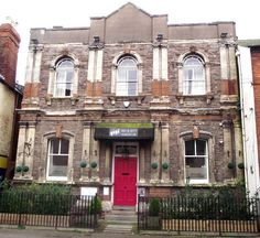 At the top of dirty Union Street near frightful Bath Street in Hereford is the Old Dispensary by Lewis Powell and Thomas Davis 1880-1 in a sort of faux renaissance style. It's built in the beautiful, dark but very crumbly Beerstone from Beer in Devon. It's been badly treated by a series of ghastly drinking clubs and looks seedy. The exciting Beerstone façade should be cleaned and stabilized, and the perspex signage removed.