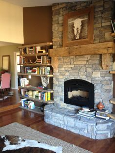 Wonderful home owner project.  Wood barn beam fireplace mantle and 2x12 barn plank shelving. Photo by Jason