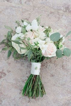 This elegant-yet-natural bouquet by Carolyn's Flowers features trailing eucalyptus amongst the roses, ranunculus, and hydrangeas.