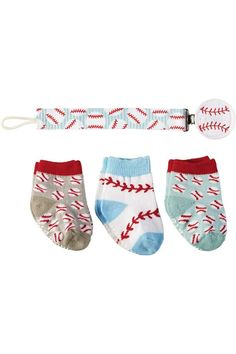 """Three pairs of baseball printed cotton socks. Comes with a pacifier clip measuringand with printed grosgrain ribbon.    Approx. Measures: sized for up to 12 months;10"""" long pacifier clip   Baseball Sock Set by Mud Pie. Home & Gifts - Gifts - Gifts by Occasion - Baby & Kids Boulder, Colorado"""