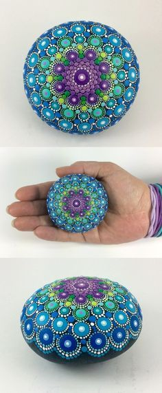 "Mandala Stone (Medium) by Kimberly Vallee: Hand painted with acrylic and protected with a matt finish, this medium sized Dot Painted Mandala Stone is a little over 2.5"" diameter. It is one-of-a-kind."