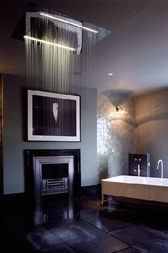 A shower with a fireplace! What's nor to love?! Photography by Kilian O'Sullivan