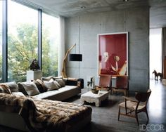 In the living area of Christian Boros and Karen Lohmann's Berlin apartment, furnishings both vintage and new mix with contemporary art, including a Wolfgang Tillmans photograph of Kate Moss.