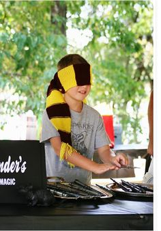 """Blindfold your guests and have them hover their hands over the wands until the right one """"chooses"""" them. Find this idea and more here."""