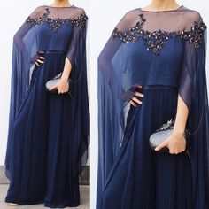 'A woman makes an outfit her own with accessories' - Oscar De La Renta Accessorized the Midnight Blue, Cascading-Cape Jumpsuit… Pakistani Dresses, Indian Dresses, Indian Outfits, Indian Attire, Indian Wear, Cape Jumpsuit, Jumpsuit Outfit, Cape Gown, Indian Couture
