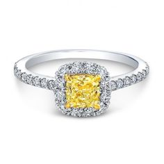 This fancy yellow cushion cut halo engagement ring is actually affordable! I love it! So pretty and unique!
