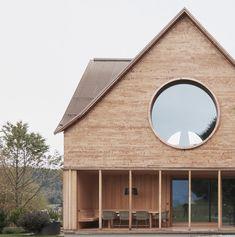 Innauer-Matt Architekten completes House with Three Eyes in rural Austria.