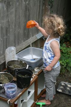 Make an outdoor concoctions kitchen with fresh herbs, mud, flowers and water for endless hours of fun!