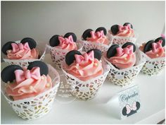 Pretty cupcakes at a Minnie Mouse birthday party! See more party planning ideas at CatchMyParty.com!