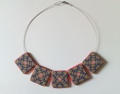 polymer clay necklace with rectangular beads decorated with handmade kaleidoscopic pattern