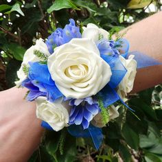 This Delphinium and Rose Corsage combines the softness of white sweetheart roses with the deep vibrant tones of blue delphinium. Prom Bouquet, Prom Corsage And Boutonniere, White Boutonniere, Blue Bouquet, Bride Bouquets, Corsages, Homecoming Flowers, Homecoming Corsage, Prom Flowers