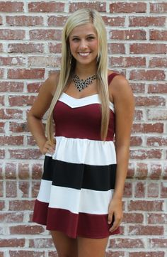 This super cute Shaye Blue Bianca Dress is absolutely perfect for game day! The fabric is extremely comfortable and stretchy. The large stripes of garnet, white, and black really help show off your game day pride! This dress does run small, so keep in mind that it might be a good idea to order one size larger than you normally would!