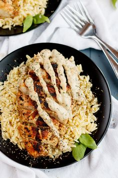 Tomato Basil Aioli Chicken - Simple chicken dish with a tomato-basil aioli sauce and served on a bed of orzo pasta.
