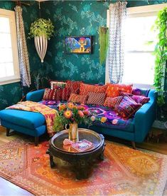 While decorating this room, the main element that we used for its adornment in bohemian style designs is layering and the delightful combining of different products. The use various textures, shades, fabric and even the patterns all are giving this room a perfect bohemian room decor.