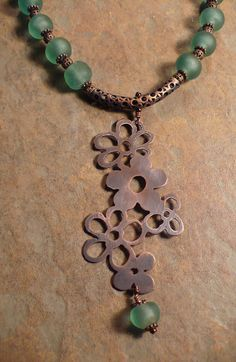 Allison Norfleet Bruenger -Falling Flowers in Copper | Copper, Riveted, Copper chain,Recycled Glass, and Seed beads