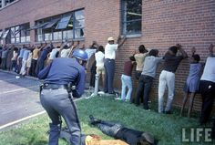 A Detroit police officer lines up people as riots ensue in late July Photo credit: Declan Haun / Getty Images — in Detroit, Michigan. Detroit History, Us History, Black History, American History, Detroit Riots, Detroit Michigan, Fotojournalismus, Babylon The Great, Black Presidents