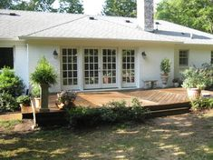 french doors + deck (ranch style house) - this is a good example of what I want across the back of house