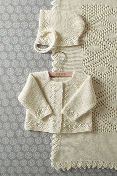 """Heirloom Layette- Blanket Bonnet Sweater Pattern [   """"Heirloom Layette- Blanket Bonnet Sweater by Kerin Dimeler- Laurence"""",   """"Spring is the celebration of life, so I rounded up a few of my favorite baby patterns. From mobiles to layettes to blankets to celebrate the new lives!"""",   """"This hat, sweater, and blanket set is a true treat for any new baby. The blanket is made in one piece, with a diamond shape and a border knit on at the end. This set is a true classic!"""" ] #<br/> # #Baby…"""
