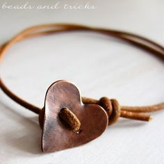 Copper heart button as a fastener on a leather bracelet--simple perfection.
