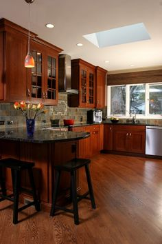 Black or stainless steel cabinets, dark cherry cabinets, tile or hard wood  floors!!