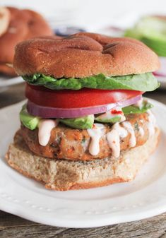 Sweet Potato and Black Bean Turkey Burgers with Sriracha-Lime Crema. These insanely flavorful and nutritious turkey burgers will blow your mind. (Great lettuce-wrapped and over salads too!)