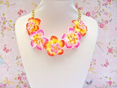 Hey, I found this really awesome Etsy listing at https://www.etsy.com/listing/183574783/orange-pink-kawaii-necklace-hawaiian-lei