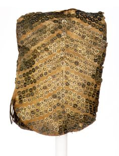 Native American, Sitka Tlingit armor, moose hide and Chinese coins, 30 1/3 x 21 1/4 in. (77 x 54 cm). Collected by George T. Emmons in 1894, American Museum of Natural History. Chinese coins were used as currency during the Qing dynasty. Most were minted in the Shunzhi (1644–62), Kangxi (1662–1723), and Yongzheng (1723–36) eras, as identifiable by their reign marks. The Tlingit received Chinese coins in trade from Boston sea merchants in exchange for sea otter pelts.