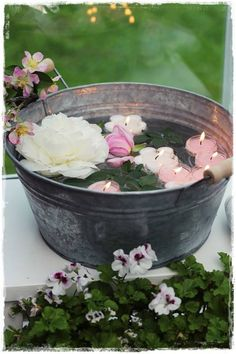Floating candles and flowers in a galvanized tub