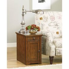 Shop for Signature Designs by Ashley Power Chairside End Table. Get free shipping at Overstock.com - Your Online Furniture Outlet Store! Get 5% in rewards with Club O! - 16337312