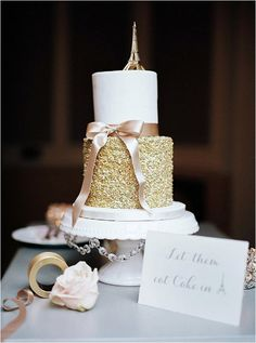 gold and cream wedding cake in Paris | Image by Giane Lima Photography