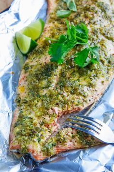 Cilantro and Lime Salmon 2 tablespoons oil 1 lime, juice and zest 2 tablespoons cilantro, coarsely chopped jalapeno, coarsely chopped (optional) 1 clove garlic, coarsely chopped salt and pepper to taste 2 pound salmon fillet Salmon Recipes, Fish Recipes, Seafood Recipes, Cooking Recipes, Healthy Recipes, Recipies, Think Food, I Love Food, Good Food