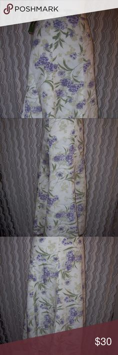 NWT Eddie Bauer Floral Lined Skirt Sz 14 Women's lined long skirt New with tags Eddie Bauer brand  Size 14 Cream colored with purple and green floral pattern  Solid cream colored lining  Side zipper with hook & eye closure  Fabric is a blend of tencel and linen with a polyester lining  Measures about 35 inches long waist to hemline  Measures about 18 inches across or 36 inches around at the waist  Hips measure about 22 inches across or 44 inches around Eddie Bauer Skirts Midi