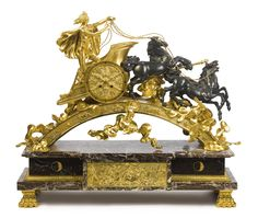 AN EMPIRE STYLE GILT AND PATINATED BRONZE MANTEL CLOCK DEPICTING APOLLO THE SUN GOD DRIVING HIS CHARIOT, AFTER A MODEL BY PIERRE-PHILIPPE THOMIRE 19TH CENTURY