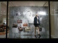 Drawn collection at Coach window display, New York - Black and white drawings of classic styled bags and leather goods show up to decorate the windows at Coach in New York. Just simple, enlighted and graphic.