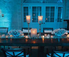 With low lying centerpieces and tall silver candlesticks, guests can easily converse throughout the dinner in style.