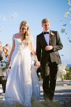A pretty wedding ceremony exit on the beach | @christastrick | Brides.com